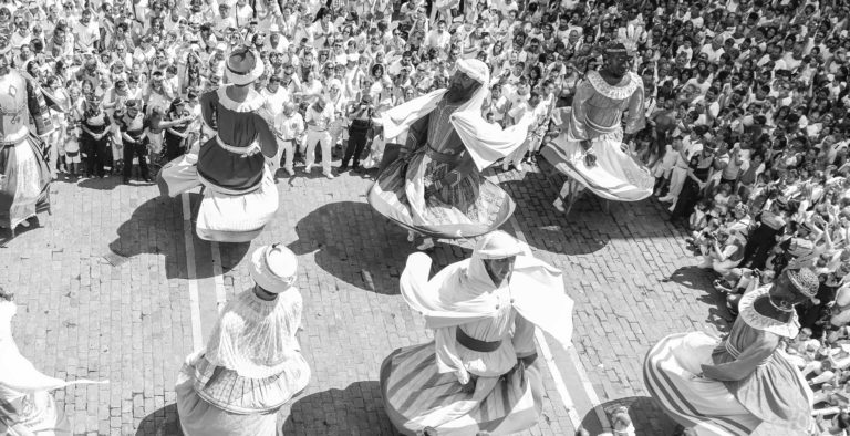 festival with masked dancers